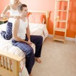 Woman Massaging Man's Shoulders in Bedroom — Stock Photo