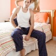 Woman Massaging Man's Shoulders in Bedroom — Stock Photo #2628088