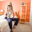 Couple Relaxing in Their Bedroom — Stock Photo #2628096