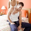 Affectionate Couple Laughing in Bedroom — Stock Photo #2628099