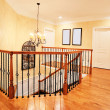 Upper Hallway and Staircase in Upscale Home - Stock Photo
