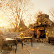 Sunlit Patio With Stone Fireplace - Stock Photo