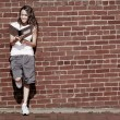 Brick Wall Notebook Girl — Stock Photo #2628421