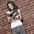 Brick Wall Notebook Girl — Stock Photo