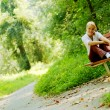 Girl on Forest Bench — Stock Photo