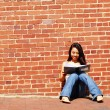 Stok fotoğraf: Girl Writing In Note Book