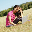Girl on Laptop in Meadow — Stockfoto