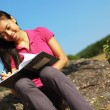 Stock Photo: Girl Writing in Note Book