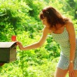 Foto Stock: Girl Checking Mail