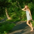 Pretty girl on forest path — Stock Photo #2629040