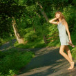 Pretty girl on forest path — Stockfoto