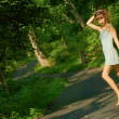 Pretty girl on forest path — Foto de Stock