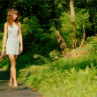 Pretty girl on forest path — Foto Stock