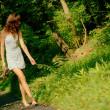 Pretty girl on forest path — Photo