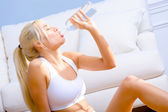 Young Woman Drinking Bottled Water — Stock Photo