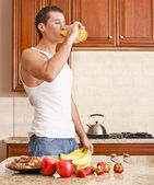 Young Man Drinking Orange Juice — Stock Photo