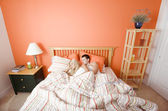 Young Couple Sleeping in Bed — Stock Photo