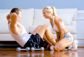 Couple Exercising on Living Room Floor — Stock Photo