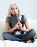 Contemplative Woman Sitting on Couch and Holding — Stock Photo