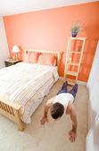 Man Doing Push-Ups in Bedroom — Stock Photo