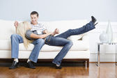 Affectionate Couple Relaxing Together on Couch — Stock Photo