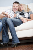Affectionate Couple Laughing and Relaxing on Cou — Stock Photo
