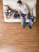 Overhead View of Couple Relaxing on Couch — Stock Photo