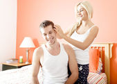 Affectionate Couple in Bedroom — Stock Photo
