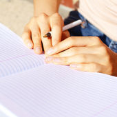 Girl Writing In Note Book — Stock Photo