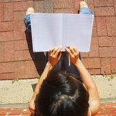 Girl Writing In Note Book — Stok fotoğraf