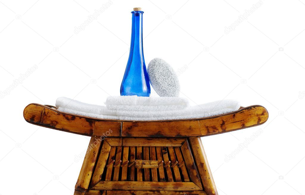 Bed and bath objects on top of an ornate stand.  Stock Photo #2621971