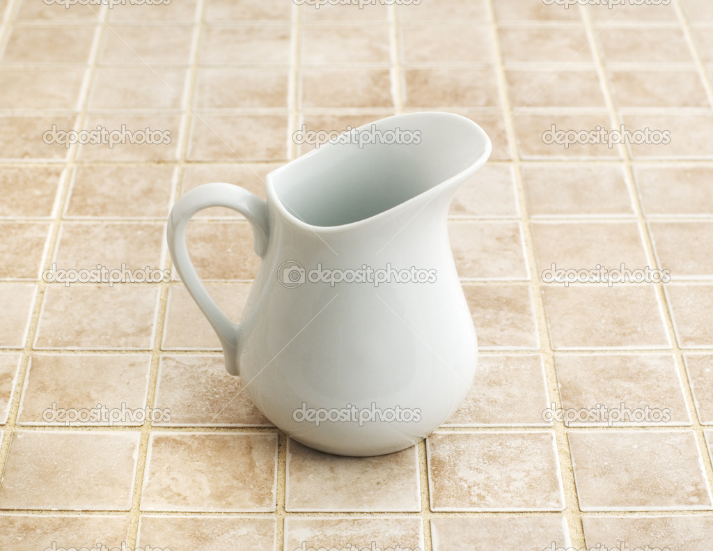 Bathroom object photographed against a stone tile backdrop.  Stock Photo #2623460
