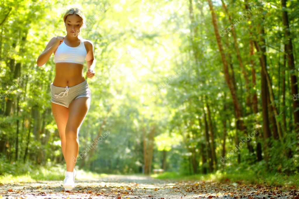 Pretty young girl runner in the forest. — Stock Photo #2628496