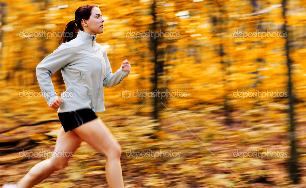 Beautiful young woman running in a fall forest. — Stock Photo #2629604