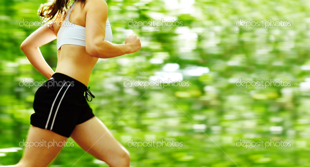 Beautiful young woman runner in a green forest. — Stock Photo #2629606