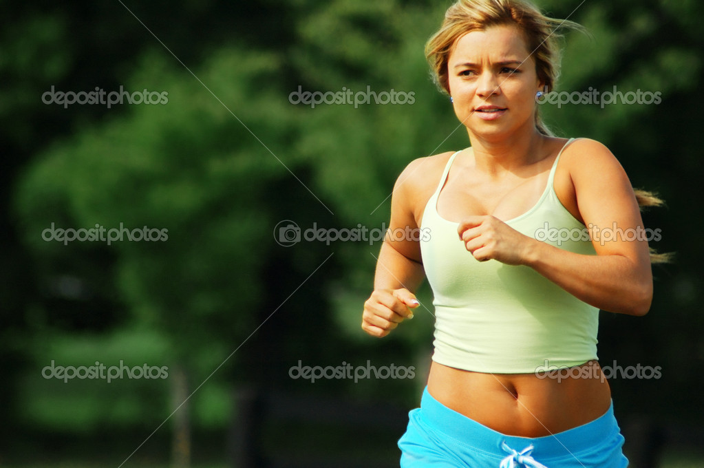 Beautiful girl jogging on a summer day.  Stock Photo #2629702