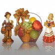 Thanksgiving pilgrims and fruit basket — Stock Photo