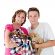Couple with three Shar Pei baby dogs — Stock Photo