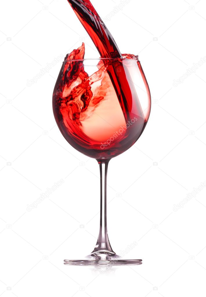 Red wine splashing in a glass, isolated on white  Stock Photo #2075589