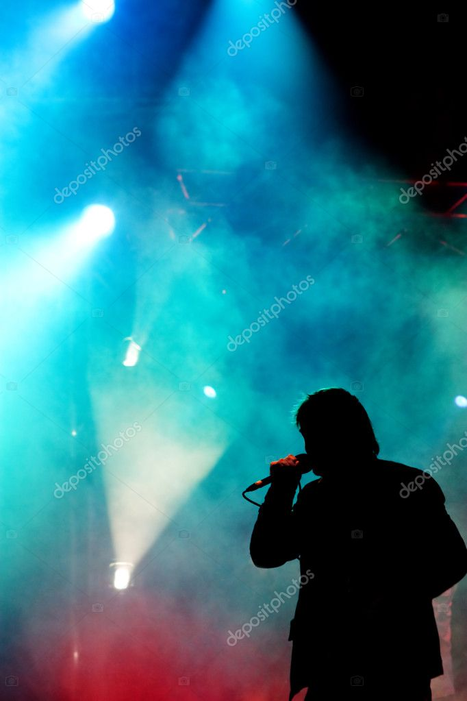 Silhouette of a singer performing on a stage  Stock Photo #2076430