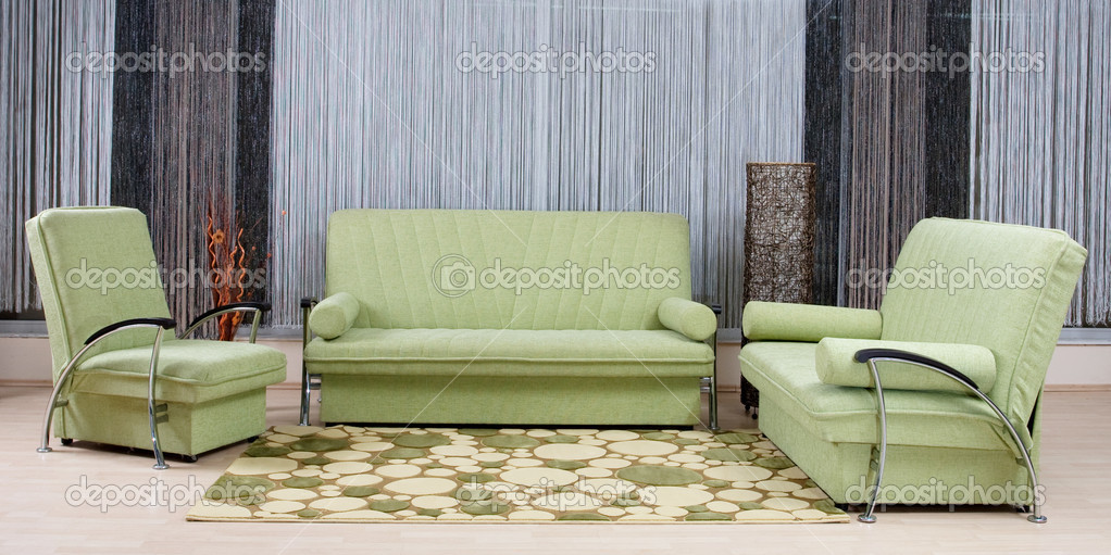 Green luxury sofa in a living room — Stock Photo #2078971