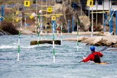 Kayaker manoeuvring in white water — Stock Photo