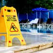 Caution wet floor sign - Stock Photo