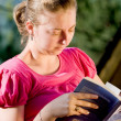 Girl reading a book — Stock Photo #2091047