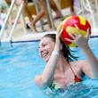 Girl playing in a water-pool — Stock Photo #2091061