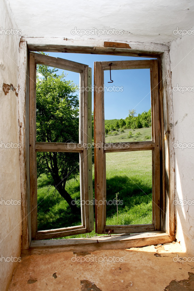 Landscape view through an old window — Stock Photo #2101439
