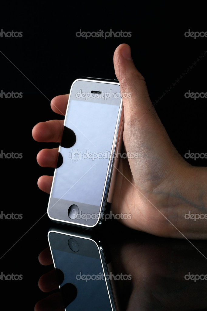 Hand holding mobile phone, with reflection  Stock Photo #2103262