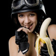 Portrait of a girl eating banana — Stock Photo