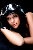 Girl with US Army motorcycle helmet — Stok fotoğraf