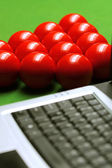 Snooker balls and laptop — Stock Photo